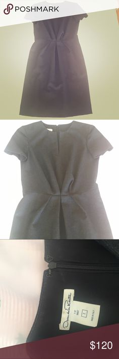 Oscar de la Renta Wool dress: SO Audrey Hepburn😍 Amazingly classy as f$&! Oscar de la Renta Wool flannel dress in a perfect grey! Short sleeves, straight skirt and pinched waist with gorgeous pleats. Notched at Collar/ neck. A truly amazing vintage piece. Oscar de la Renta Dresses
