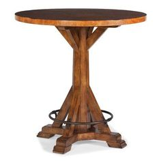 Features:  -Matched veneer top.  -Metal footrest ring.  Product Type: -Pub table.  Table Base Type: -Pedestal.  Table Shape: -Round.  Style: -Rustic.  Table Finish: -Cognac.  Distressed: -Yes.  Table                                                                                                                                                                                  More