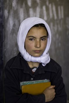 Today's photo of a young Hazara school girl was taken in Bamiyan, Afghanistan. Steve McCurry.