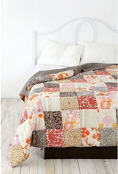 Quilt from Uban Outfitters.  Inspiration - I love the color pattern, and the large squares are quick and easy.