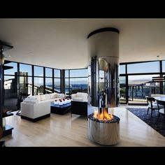 Wide open area, delightful free-standing fireplace and what about the view!