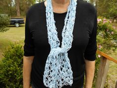 This scarf is made of two strands of crochet thread, one blue and the other white.www.KaysKoolKrochet.Etsy.com