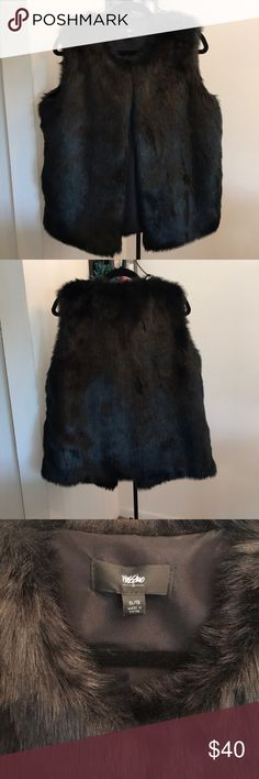 Black Faux Fur Vest - Women's Women's Black Faux Fur Vest - Mossimo Supply Co. Size - XL  I love this vest, I only wore it ONCE! I'm only selling it because it's too big!   Comes from smoke free & pet free home!   Faux Fur Shell 77% Acrylic  23% Polyester  Lining 100% Polyester Mossimo Supply Co. Jackets & Coats Vests