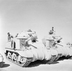 BRITISH ARMY NORTH AFRICA (E 14054) Grant and Lee tanks of 'C' Squadron, 4th (Queen's Own) Hussars, 2nd Armoured Brigade, El Alamein position, Egypt, 7 July 1942.