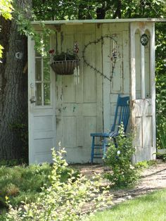 chippy white doors to make a shed....blue painted chair.....a place to ponder...love...