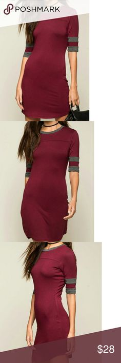 """COMING SOON! Varsity Tee Dress New with Tags A filled tee dress with a varsity jersey - inspired stripes sleeve accent, round neck and finished U-hem. Unlined.  COLOR: Wine/ Burgundy  95% Rayon, 5% Spandex  Hand wash cold  Model is wearing size S Model is 5'9"""", 32"""" bust, 23"""" waist, 35"""" hips Dresses Mini"""