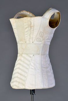 White cotton corded corset with green stitching, American or European, ca. 1820, KSUM 2011.12.37.