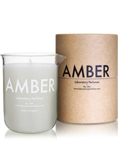 Lovely warm new British niche fragrance in a candle, in a lab beaker.