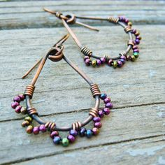 Copper Wire Wrapped Seed Beaded Hoops with Iris Purple Seed Bead Petals Wrapped with Peacock-colored beads - maybe something like this for the bridesmaids?Wrapped with Peacock-colored beads - maybe something like this for the bridesmaids? Copper Jewelry, Wire Jewelry, Jewelry Crafts, Jewelry Art, Beaded Jewelry, Jewelery, Jewelry Design, Copper Wire, Antique Copper