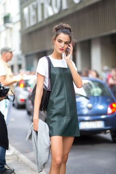 Green leather jumper over a tee with a Chanel bag.
