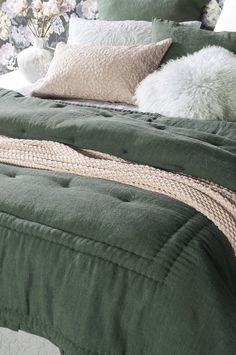 Featuring Bianca Lorenne's signature French knot clusters, this gorgeous comforter is made from a pine green linen chambray, reversing to a cotton poplin.