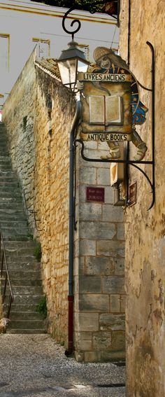Antique Bookstore in St Emilion, France. Just Wine, Beautiful Library, St Emilion, Pub Signs, World Of Books, Street Lamp, Photography Gallery, Store Signs, Book Nooks