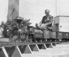 Walt Disney enjoying the miniature steam train that used to run in the back yard of his home in Holmby Hills, CA.