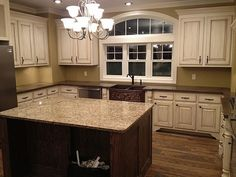 White molding and distressed cabinets with wood floors