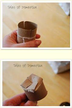 TP rolls into peat pots. The bottom is folded so it isn't open
