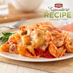 A pasta casserole recipe featuring chicken breast, pasta shells, tomatoes and cheese combined and baked to melt the cheese