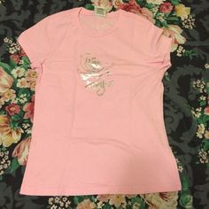 NEW LISTING  Light Pink Roxy Shirt I've only used this a handful of times, it needs a new loving home  100% cotton. Machine wash cold, tumble dry low. ⛔️ NO TRADES, NO PAYPAL, NO MERCARI, NO HOLDS ⛔️ smoke free, pet free home  let me know if you have other questions  PLEASE MAKE OFFERS THROUGH THE OFFER BUTTON. Roxy Tops
