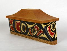 """Eagle Canoe BoxSize: 12"""" x 5"""" x 5 1/2"""" Price: $ 2400.00 CAN Hand carved and painted steam bent yellow cedarDesign meaning: Honor, Power, Leadership, Wisdom."""