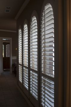 A series of perfect arched plantation shutters made in Dallas, Texas at Sewell Shutters!
