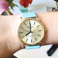 Chic retro watch with stainless steel gold face and baby blue leather band. Wear this time piece ever day this Fall season for an extra chic style!