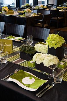 Square glass boxes in varying sizes are wrapped in suede and filled with green and white blooms.