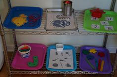 Tot trays with each of the four Montessori learning categories: Language, Sensory, Mathematics, Practical Life. Left out all week.