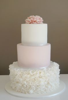 3 tier cake with ruffle rose bottom tier and ruffle flower topper