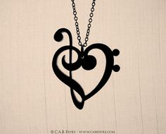 Treble & Bass Clef Heart Necklace - Laser Cut Acrylic - Music Notes. $15.00, via Etsy.