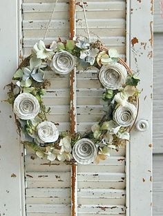 This petite wreath measuring just 8 inches was created by layering garden moss over grapevine and dusting it with dried hydrangea petals, then adding my vintage book page roses. It all hangs from a twine hanger. Perfect to hang anywhere you need a bit of shabby cottage!  Measures 8 x8 *****This is a stock photo, each comes out a little different bust just as lovely