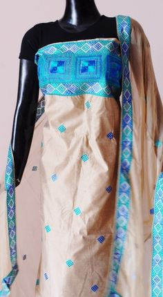 Stand out in the next party you attend wearing this amazingly graceful tussar silk phulkari suit piece, with chiffon dupatta. The kurta and dupatta have machine phulkari work on them, and the salwar is plain silk in beige. - See more at: http://www.giftpiper.com/TussarSilkBeigePhulkariSuitPiece-BluePattern-id-542174.html#sthash.Uk43zge1.dpuf