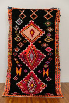 Good lord this GALAGA boucherouite vintage moroccan berber rug from Coco Carpets is stunning.