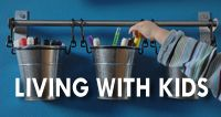 This rail with hooked canisters (IKEA) holds markers, crayons, and glue sticks. Need some crayons? Just unhook the can and take to the table...all within reach. | DIYDelRay