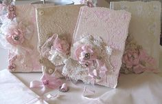 shabby chic lace journals--so cute        Could cover it with vintage scrapbook paper, lace, thin ribbon,  and flowers.  Also, looks like a doily on one of them.  The other one could be made with glue swirls and then painted and slightly antiqued.