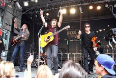 Snapshot: June 28 - Doobie Brothers' Patrick Simmons, Tom Johnston And John McFee - Takin' it to the stage. The Doobie Brothers' Patrick Simmons, Tom Johnston and John McFee rile up the crowd during a performance on June 28 in New York