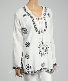 Another great find on #zulily! White & Black Embroidered Floral Tie-Neck Tunic #zulilyfinds