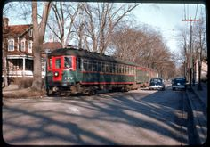 North Shore train, led by No. 177, is turning from Greenleaf Avenue onto private right-of-way at the Wilmette Main Station on March 4, 1951.