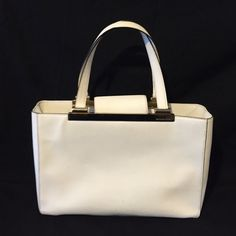 Michael Kors White Leather Tilda Tote Beautiful Michael Kors White Leather Handbag with Gold Accents. Classic MK lining. 3 inside sections with pockets, zippers and keychain attachment. Clean. Measures 14.5x9x4.5. No trades Michael Kors Bags