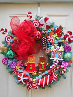 Beautifully handmade gingerbread wreath in bright, traditional colors of red and green, pink and more.Gingerbread WreathGingerbread by ornamentaltreasures on EtsyLove the cheerful candy colors in this gingerbread wreath Candyland Christmas For Kids. Candy Land Christmas, Christmas Door, Christmas Themes, All Things Christmas, Christmas Holidays, Christmas Ornaments, Christmas Swags, Burlap Christmas, Holiday Wreaths
