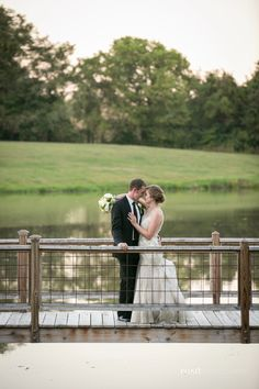 The darling couple Jessica and Taylor pose on our bridge that leads over the lake. #wedding #lake #farm #love  Photo taken by:  www.pond-photography.com