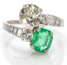 A colored diamond, emerald and diamond bypass ring; pale yellow round brilliant-cut diamond weighing approximately: 2.30 carats; cut-corner rectangular step-cut emerald weighing approximately: 3.00 carats; remaining diamonds weighing approximately: 1.00 carat total; mounted in platinum; Via Bonhams.