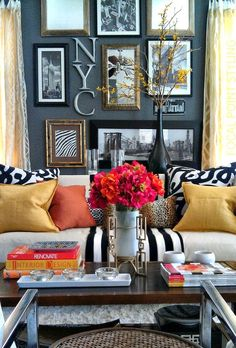 i love everything about this - the pops of color, the wall gallery, the deep charcoal-colored walls