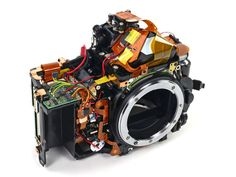 Surprisingly high-tech: What a DSLR looks like on the inside. (Nikon DSLR, without its outer chassis) Camera Nikon, Camera Gear, Photography Lessons, Digital Photography, Leica Photography, Amazing Photography, Photography Ideas, Photography Equipment, Repair Manuals