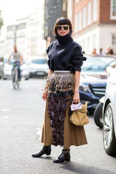 Leaf Greener in a Marni top and skirt and LOEWE bag   - HarpersBAZAAR.com