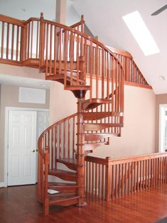"""6' 0"""" Diameter Oak Kit with included triple in-between spindles and optional A-groove handrail, 60° landing, balcony condition landing rail and starting newel posts and loft rails www.theironshop.com"""