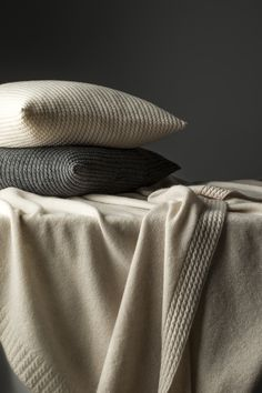'Amado' #cashmere #throws, Christian Fischbacher Ltd- Knitted from 100% cashmere, the Amado collection represents the quintessentially Christian Fischbacher style of relaxed elegance. A classic cable stitch border adds an extra touch of sophisticated detail. Available in grey and cream.