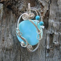 Blue Peruvian Opal--one of many cool wire wraps from this artisan