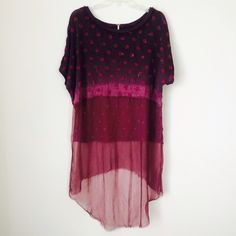 FREE PEOPLE HI-LO SHEER TUNIC Gorgeous tunic. Sheer bottom half. Great condition. NO TRADES OFFERS WELCOME Free People Tops Tunics