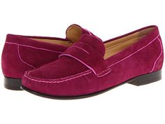 Bright pink suede loafers.