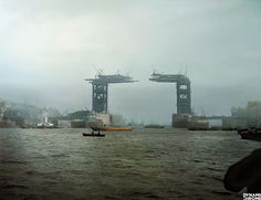 colorized photo by Jordan Lloyd of Dynamic Chrome, we see London's iconic Tower Bridge under construction in 1889
