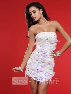 The fashion cock tail dress features the hand-made flowers and adorable beadings dotted on the breast. The short/mini hemline makes you hot. It is made of satin. Colors alter according to your preference. Sizes are from 2 to 28 in US standard.